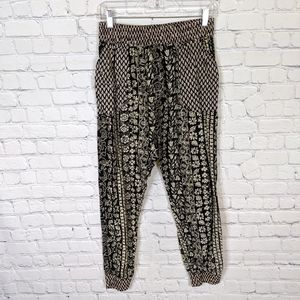 UO Staring at Stars Black Cream Harem Print Pants